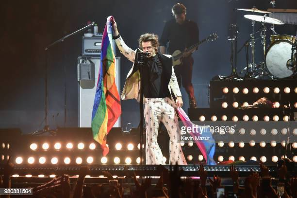 Harry Styles holds rainbow flags as he performs onstage during Harry Styles Live On Tour New York at Madison Square Garden on June 21 2018 in New...