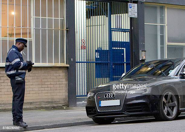 Harry Styles is pictured getting a parking ticket on March 10th 2016 in LondonEngland