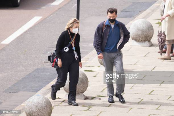 Harry Styles is seen between takes as he films 'My Policeman' on May 13, 2021 in Brighton, England.