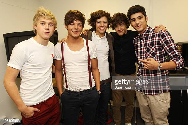 Harry Styles Liam Payne Niall Horan Louis Tomlinson and Zain Malik of One Direction pose for photographs while visiting Glasgow Manchester and London...