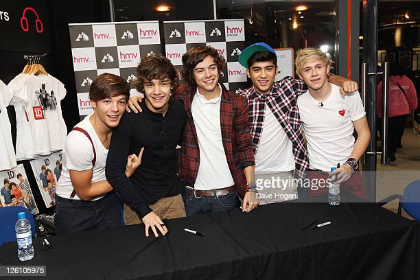 Harry Styles Liam Payne Niall Horan Louis Tomlinson and Zain Malik of One Direction sign cd's in Glasgow Manchester and London on September 11 2011...