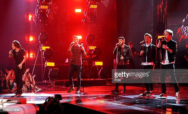 Harry Styles Liam Payne Zayn Malik Louis Tomlinson and Niall Horan of 'One Direction' performs onstage on FOX's 'The X Factor' Season 3 Live Finale...