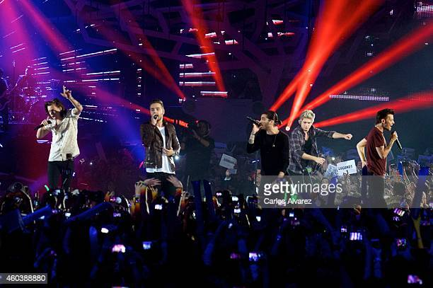 Harry Styles Liam Payne Zayn Malik Niall Horan and Louis Tomlinson of One Direction perform on stage during the '40 Principales' awards 2013 ceremony...