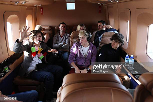LR Harry Styles Niall Horan and Louis Tomlinson of One Direction travel in a luxury helicopter to Glasgow Manchester and London on September 11 2011...