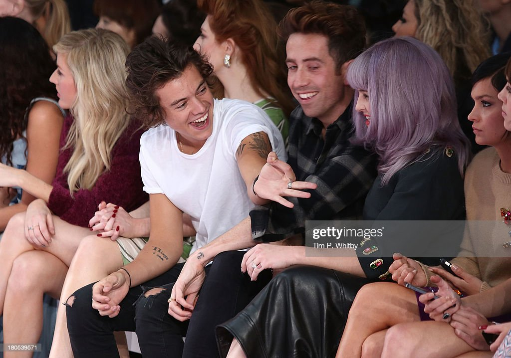 Harry Styles, Nick Grimshaw and Kelly Osbourne attend the House Of Holland show during London Fashion Week SS14 on September 14, 2013 in London, England.