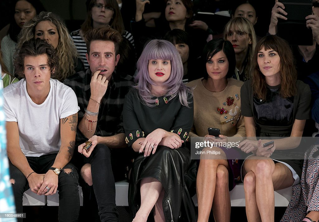 Harry Styles, Nick Grimshaw, Kelly Osbourne, Leigh Lezark and Alexa Chung attends the House Of Holland show during London Fashion Week SS14 on September 14, 2013 in London, England.