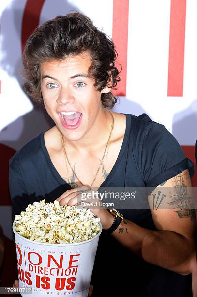 Harry Styles of One Direction attends a photocall for 'One Direction - This Is Us' at Big Sky Studios on August 19, 2013 in London, England.