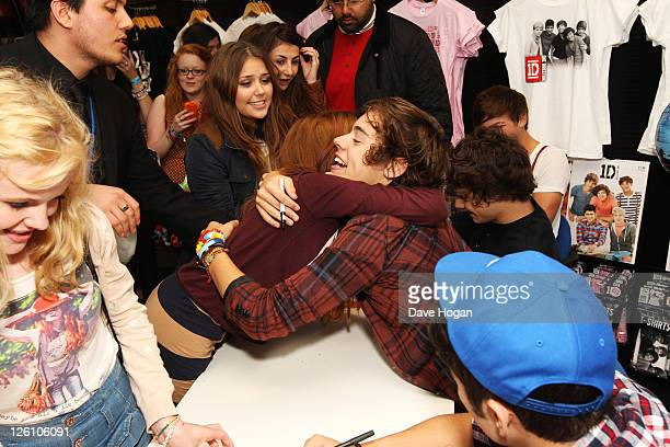 Harry Styles of One Direction hug a fan while visiting Glasgow Manchester and London on September 11 2011 The tour was taken in a luxury helicopter...