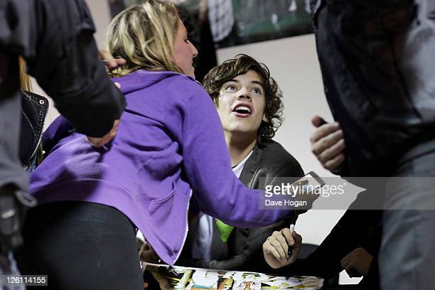 Harry Styles of One Direction meets the fans while visiting Glasgow Manchester and London on September 11 2011 The tour was taken in a luxury...