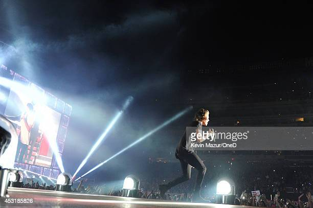 Harry Styles of One Direction performs onstage during the Where We Are tour at Met Life Stadium on August 4 2014 in New York City