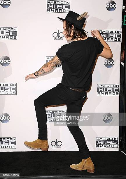 Harry Styles of One Direction poses in the press room at the 2014 American Music Awards at Nokia Theatre LA Live on November 23 2014 in Los Angeles...