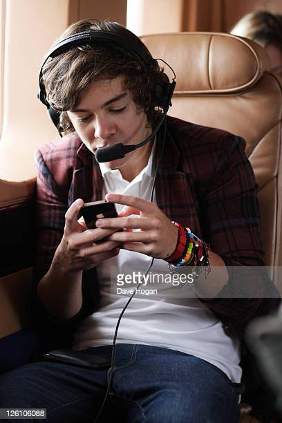 Harry Styles of One Direction travel in a luxury helicopter to Glasgow Manchester and London on September 11 2011 The tour was taken in a luxury...