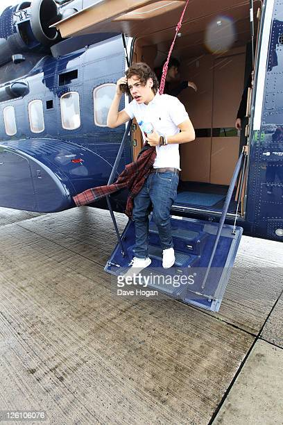 Harry Styles of One Direction travels in a luxury helicopter to Glasgow Manchester and London on September 11 2011 The tour was taken in a luxury...