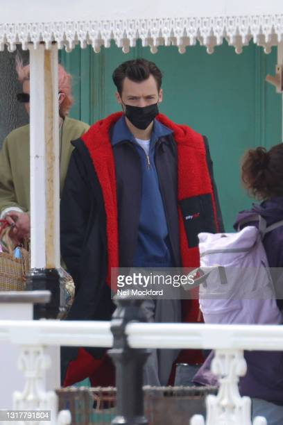 Harry Styles seen on the filmset for the 'My Policeman' on Brighton Pier on May 13, 2021 in Brighton, England.