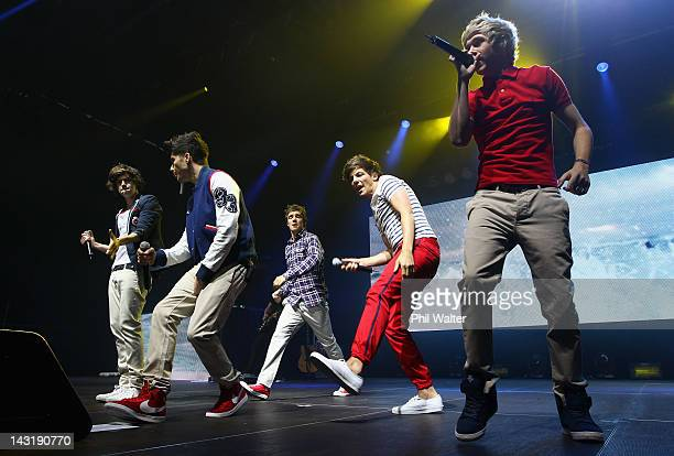 Harry Styles Zayn Malik Liam Payne Louis Tomlinson and Niall Horan of One Direction perform live on stage at Trusts Stadium on April 21 2012 in...