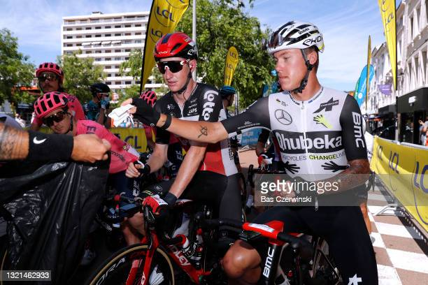 Harry Sweeny of Australia and Team Lotto Soudal & Dylan Sunderland of Australia and Team Qhubeka Assos at start in Saint-Chamond Village during the...