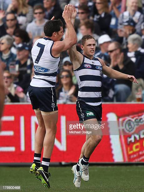 Harry Taylor and Joel Selwood of the Cats celebrate a goal during the round 20 AFL match between the Geelong Cats and Port Adelaide at Simonds...