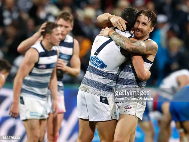 Harry Taylor nand Zach Tuohy of the Cats celebrate on the final siren during the 2017 AFL round 09 match between the Geelong Cats and the Western...