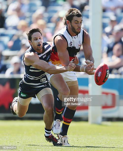 Harry Taylor of the Cats and Taylor Walker of the Crows compete for the ball during the round two AFL NAB Cup match between the Geelong Cats and the...