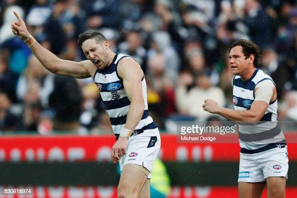 Harry Taylor of the Cats celebrates a goal during the round 21 AFL match between the Geelong Cats and the Richmond Tigers at Simonds Stadium on...