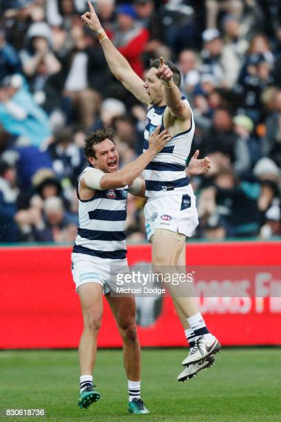 Harry Taylor of the Cats celebrates a goal with Steven Motlop during the round 21 AFL match between the Geelong Cats and the Richmond Tigers at...