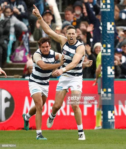 Harry Taylor of the Cats celebrates a last quarter goal with Steven Motlop of the Cats during the 2017 AFL round 21 match between the Geelong Cats...