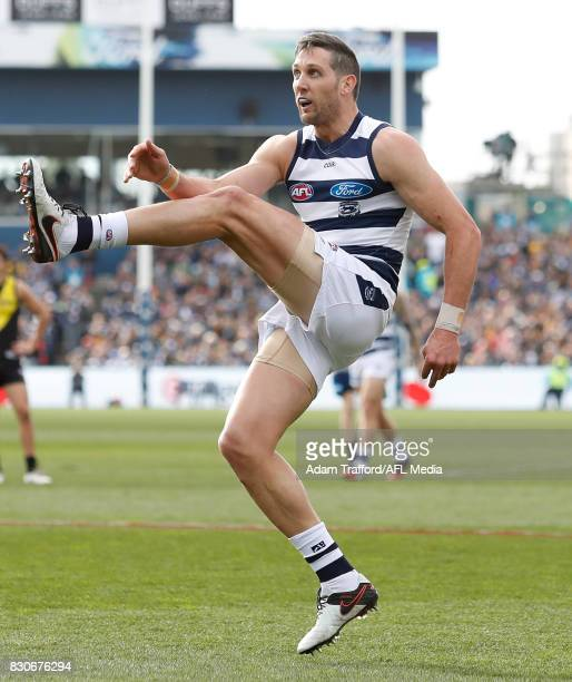 Harry Taylor of the Cats kicks the ball during the 2017 AFL round 21 match between the Geelong Cats and the Richmond Tigers at Simonds Stadium on...