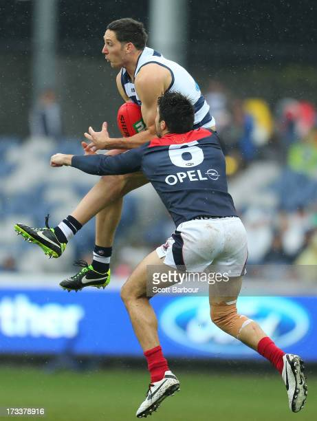 Harry Taylor of the Cats takes a mark during the round 16 AFL match between the Geelong Cats and the Melbourne Demons at Simonds Stadium on July 13...