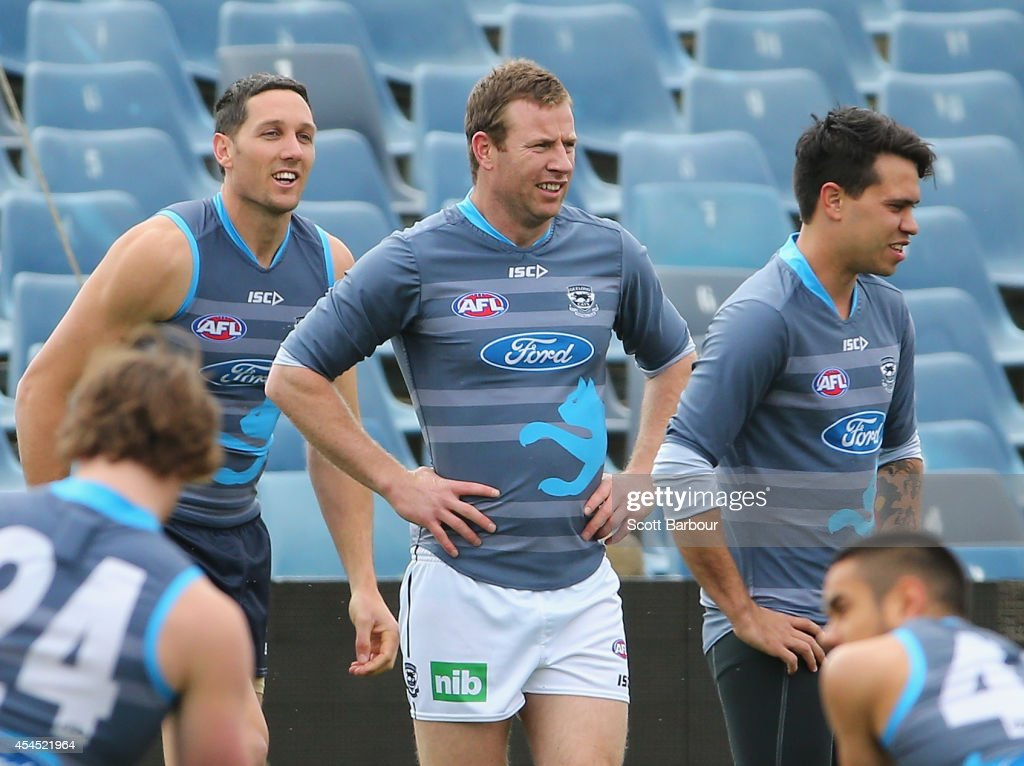 Harry Taylor, Steve Johnson and Allen Christensen of the Cats look on during a Geelong Cats AFL training session at Simonds Stadium on September 3, 2014 in Geelong, Australia.