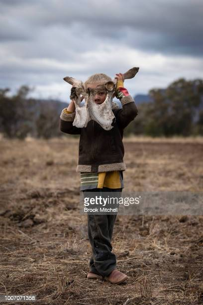 Harry Taylor wears what he calls his 'monster hat' The bones of dead livestock have become a common sight on the Taylor family farm during the...