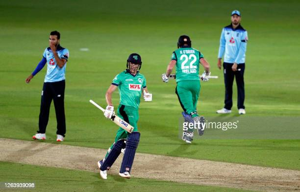 Harry Tector and Kevin O'Brien of Ireland celebrate victory watched on by Saqib Mahmood and James Vince of England during the Third One Day...