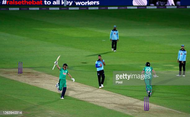 Harry Tector and Kevin O'Brien of Ireland celebrate victory watched on by Saqib Mahmood Moeen Ali and James Vince of England during the Third One Day...