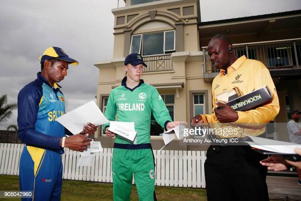 Harry Tector of Ireland and Kamindu Mendis of Sri Lanka prepare for coin toss with Umpire David Agutu prior to the ICC U19 Cricket World Cup match...