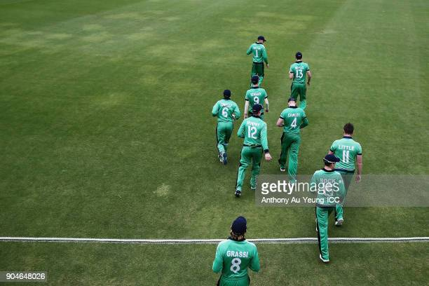 Harry Tector of Ireland leads his team onto the field for their Ireland's 2nd innings during the ICC U19 Cricket World Cup match between Sri Lanka...