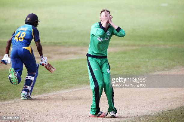 Harry Tector of Ireland reacts as Kamindu Mendis of Sri Lanka makes his run during the ICC U19 Cricket World Cup match between Sri Lanka and Ireland...