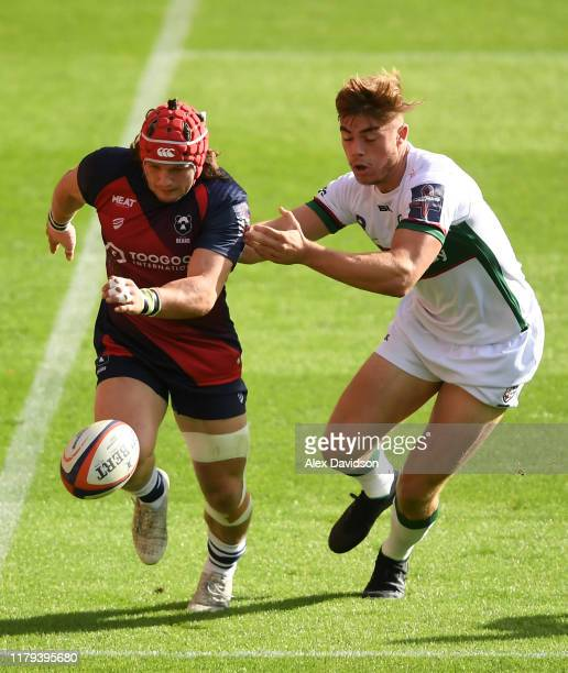 Harry Thacker of Bristol Bears chips it past Ollie Hassell-Collins of London Irish during the Premiership Rugby Cup Third Round match between Bristol...