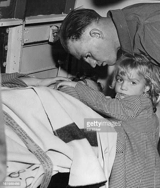 OCT 17 1956 OCT 18 1956 Harry Thayne of Maybell Colo consoles his wife Carrie during emergency flight from Craig Colo to Denver with five persons...