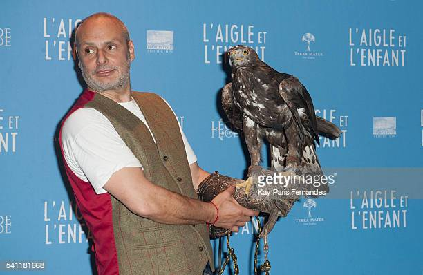 Harry the eagle handler and the eagle attend the 'L Aigle et L Enfant' Photocall at the cinema Gaumont Capucines on June 19 2016 in Paris France