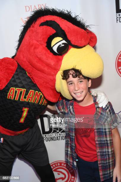 Harry The Hawk and actor Jason Drucker attends Diary Of A Wimpy Kid The Long Haul Atlanta screening hosted by Dwight Howard at Regal Atlantic Station...
