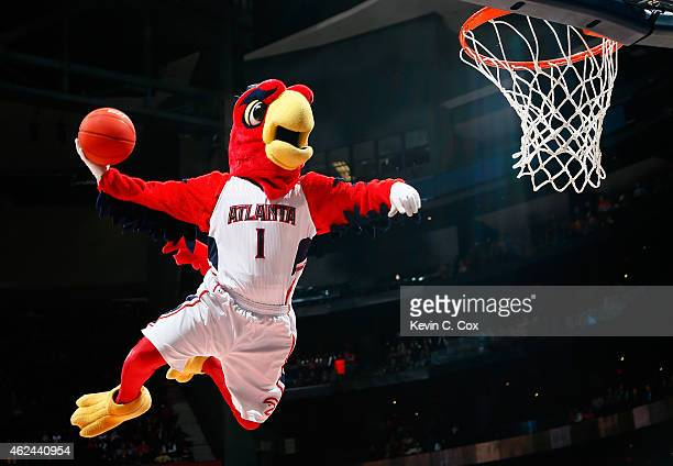 Harry the Hawk mascot of the Atlanta Hawks dunks during a timeout in the game between the Atlanta Hawks and the Brooklyn Nets at Philips Arena on...