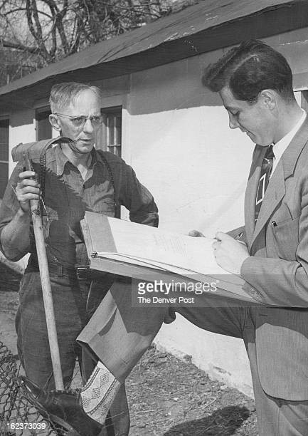 APR 13 1950 Harry Tillman patiently answers questions put to him by Fred Straface of 5152 Washington street as the U S census force took the field...