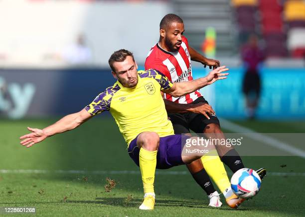 Harry Toffolo of Huddersfield Town battling for possession with Bryan Mbuemo of Brentford during the Sky Bet Championship match between Brentford and...