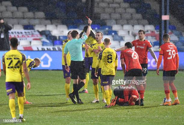Harry Toffolo of Huddersfield Town is shown a red card by referee Leigh Doughty during the Sky Bet Championship match between Luton Town and...