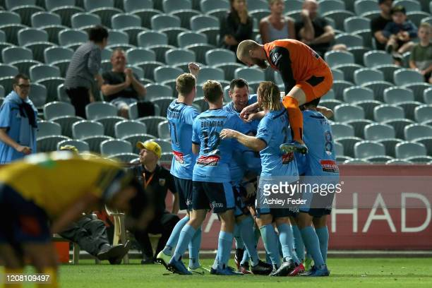 Harry Van Der Saag of Sydney FC celebrates his goal with team mates during the round 20 A-League match between the Central Coast Mariners and Sydney...