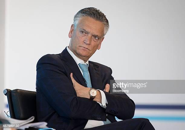 Harry van Dorenmalen chairman of International Business Machines Corp Nederland BV sits and listens during the Milken Institute London summit in...