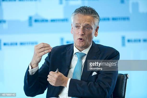 Harry van Dorenmalen chairman of International Business Machines Corp Nederland BV gestures as he speaks during the Milken Institute London summit in...