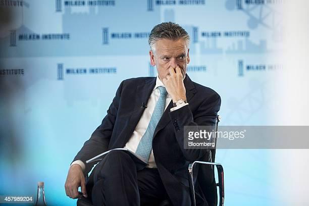 Harry van Dorenmalen chairman of International Business Machines Corp Nederland BV reacts as he listens during the Milken Institute London summit in...