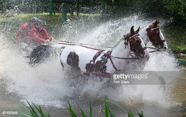 Harry Verstappen of Holland goes through the water obstacle during the Land Rover International Driving Grand Prix at the Royal Windsor Horse Show on...