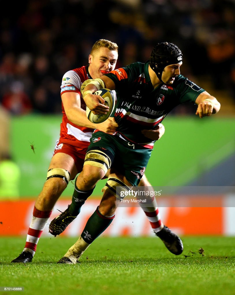 Harry Wells of Leicester Tigers is tackled by Will Safe of Gloucester Rugby during the Anglo-Welsh Cup match at Welford Road on November 4, 2017 in Leicester, England.