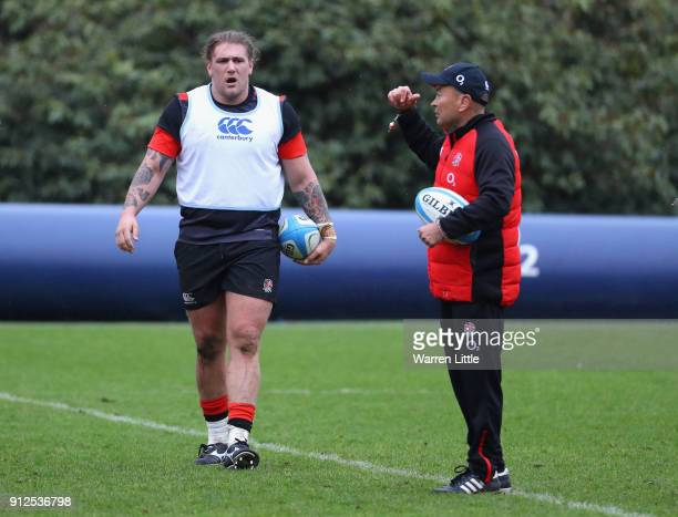 Harry Williams and Eddie Jones manager of England looks on during England media access at Pennyhill Park on January 31 2018 in Bagshot England
